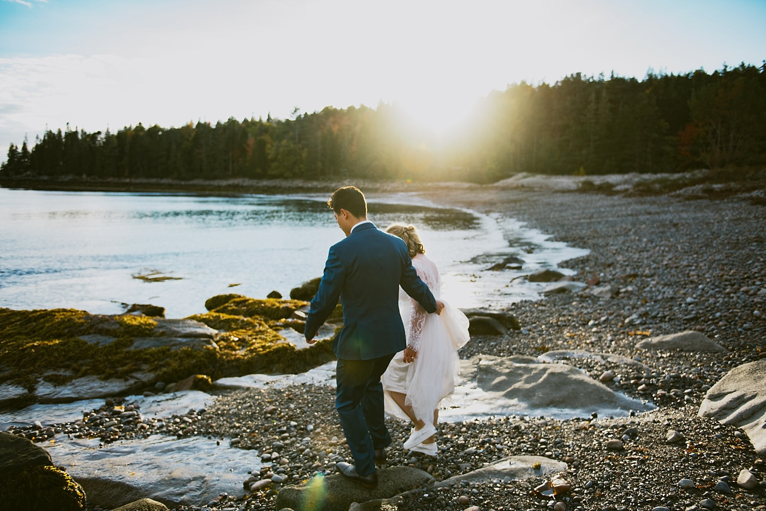 bride and groom exploring the beach