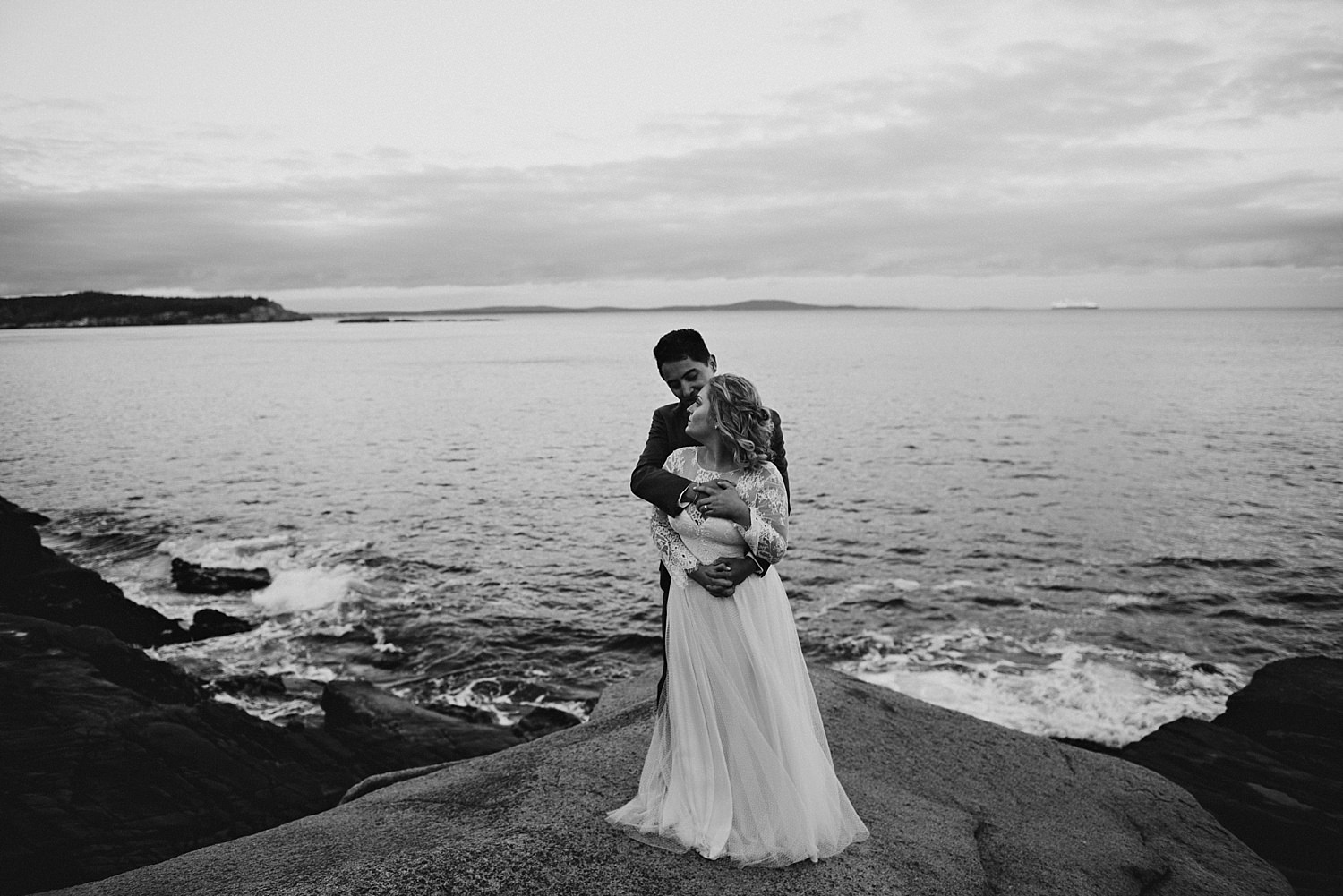 groom embracing bride on the cliffs