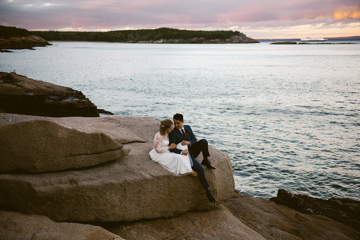 bride and groom snuggled at sunset