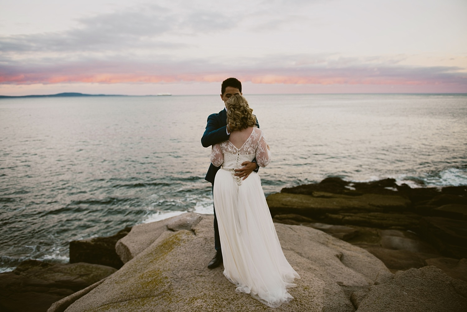 bride and groom in passionate embrace