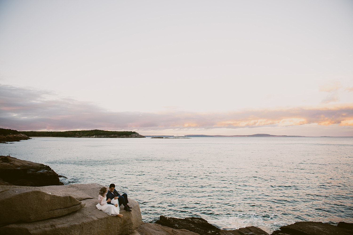 bride and groom scenic shot by the sea
