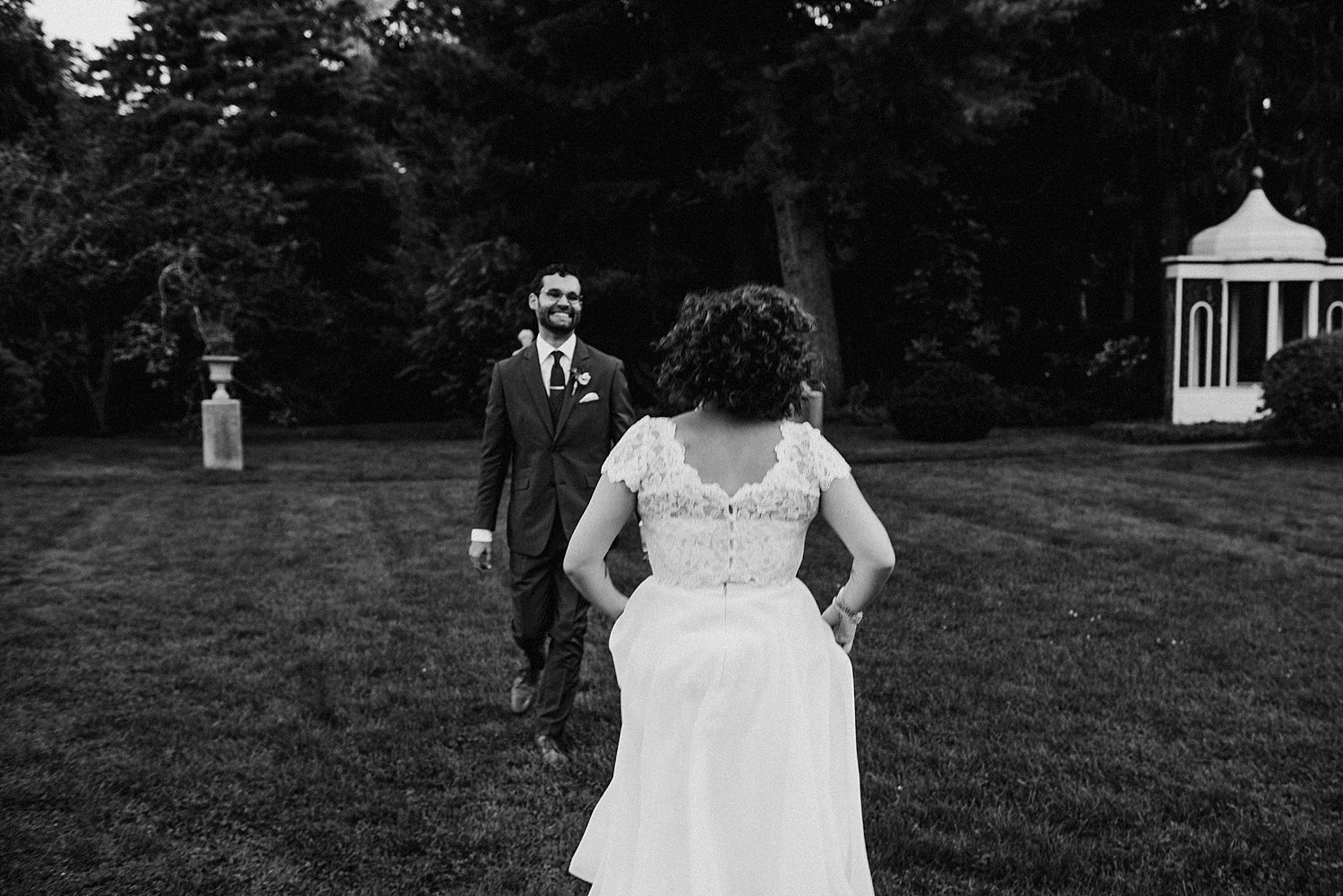 Bride running towards groom