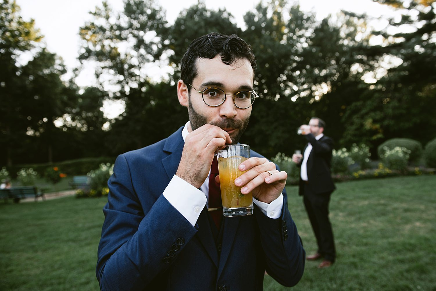 Groom and signature cocktail