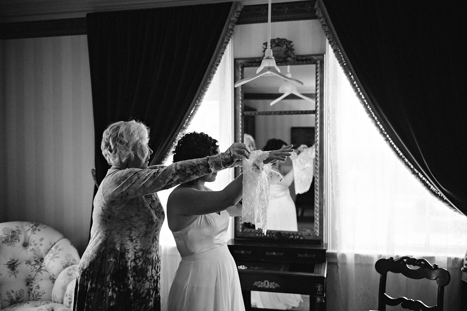 Mother of the bride helping bride
