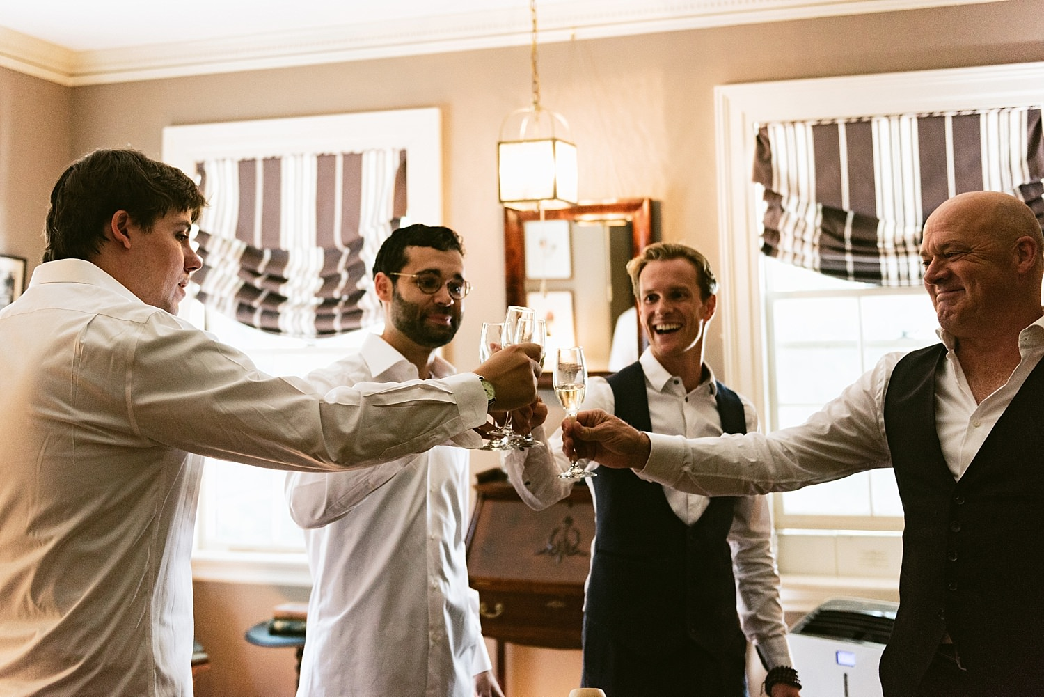 Groom and best men toasting
