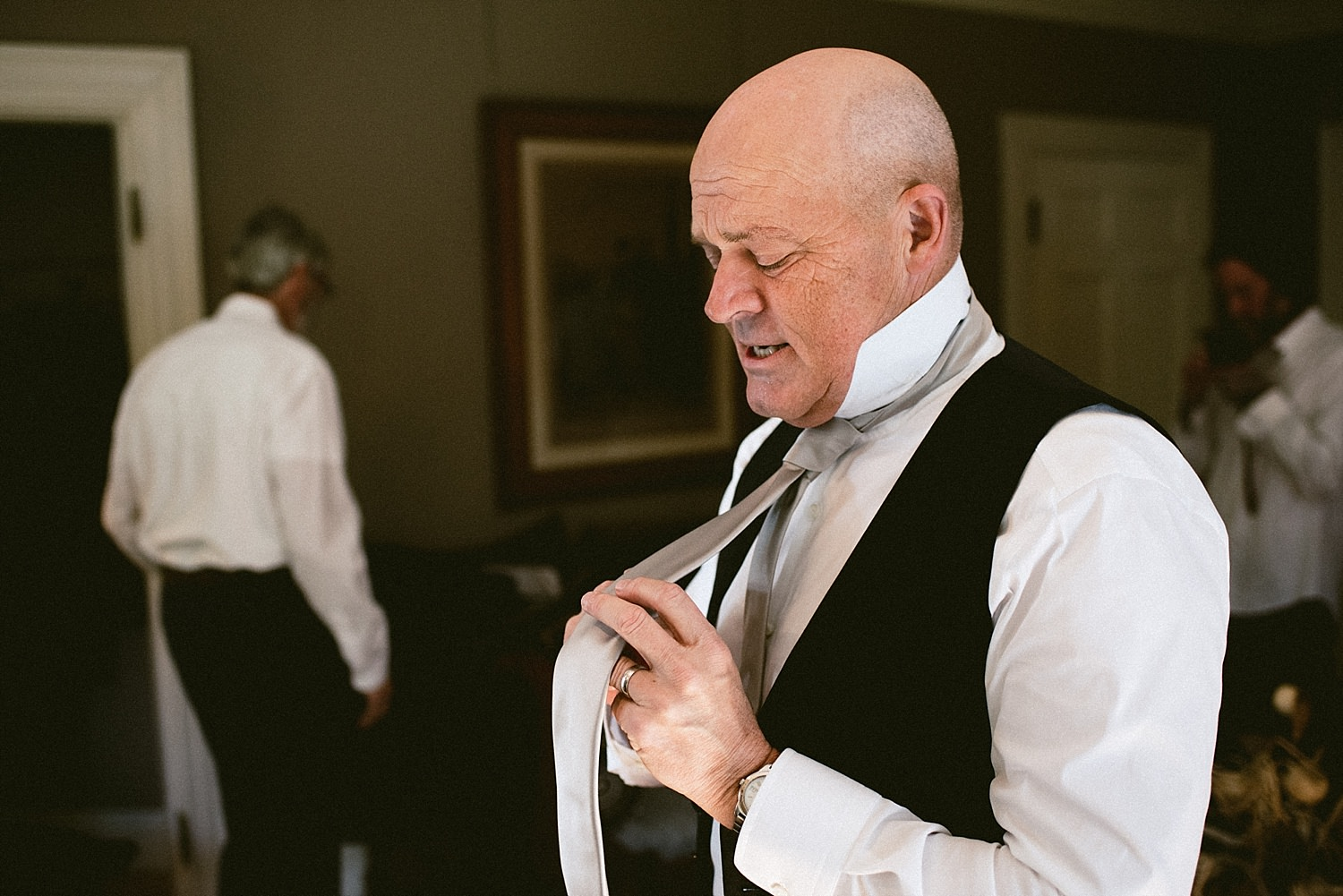 Father of groom getting ready