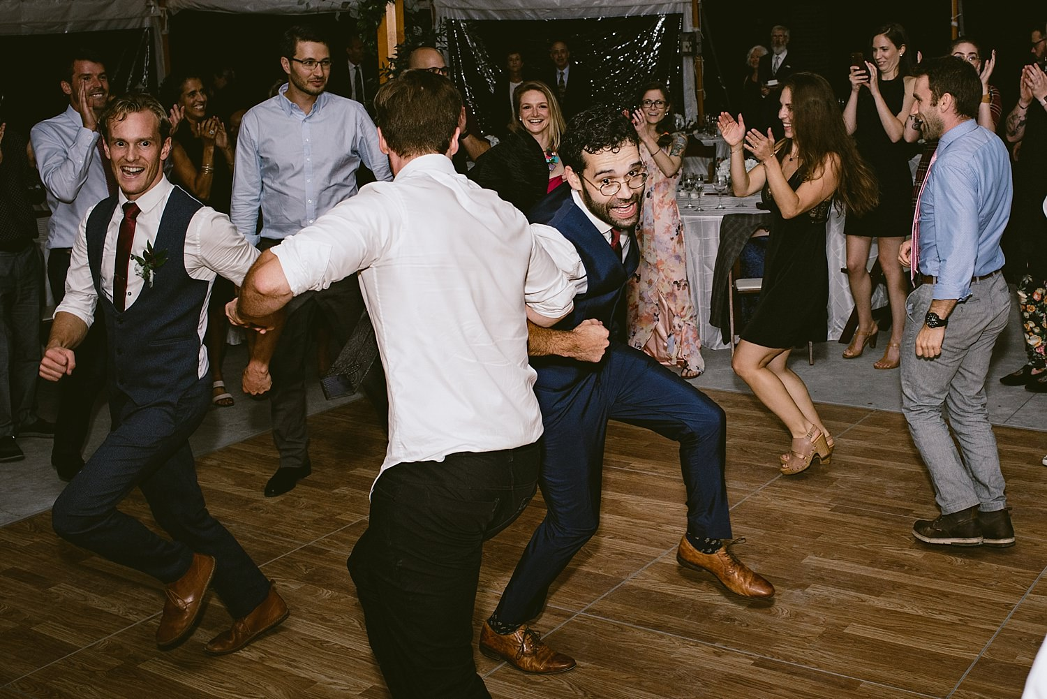 Groom dancing with grooms men