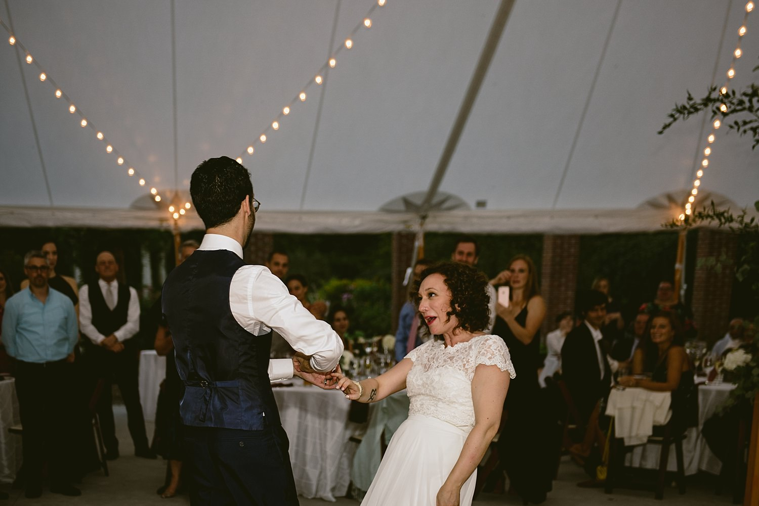 Bride and groom dancing crazy