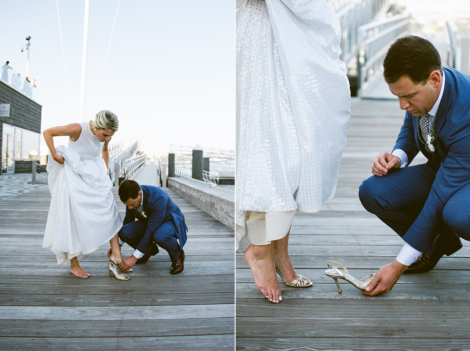 groom helping bride put on shoes