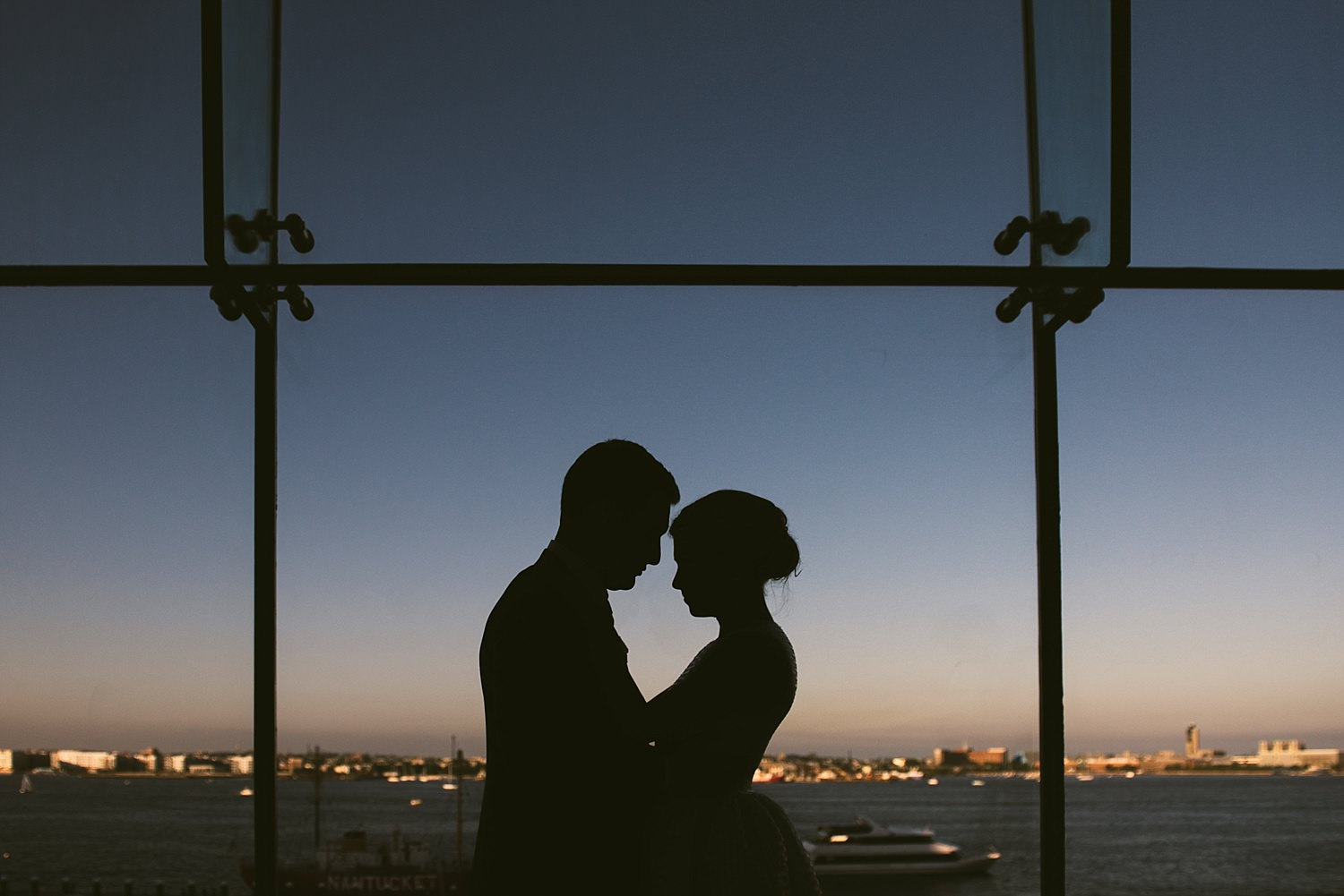 bride and groom silhouette with boston