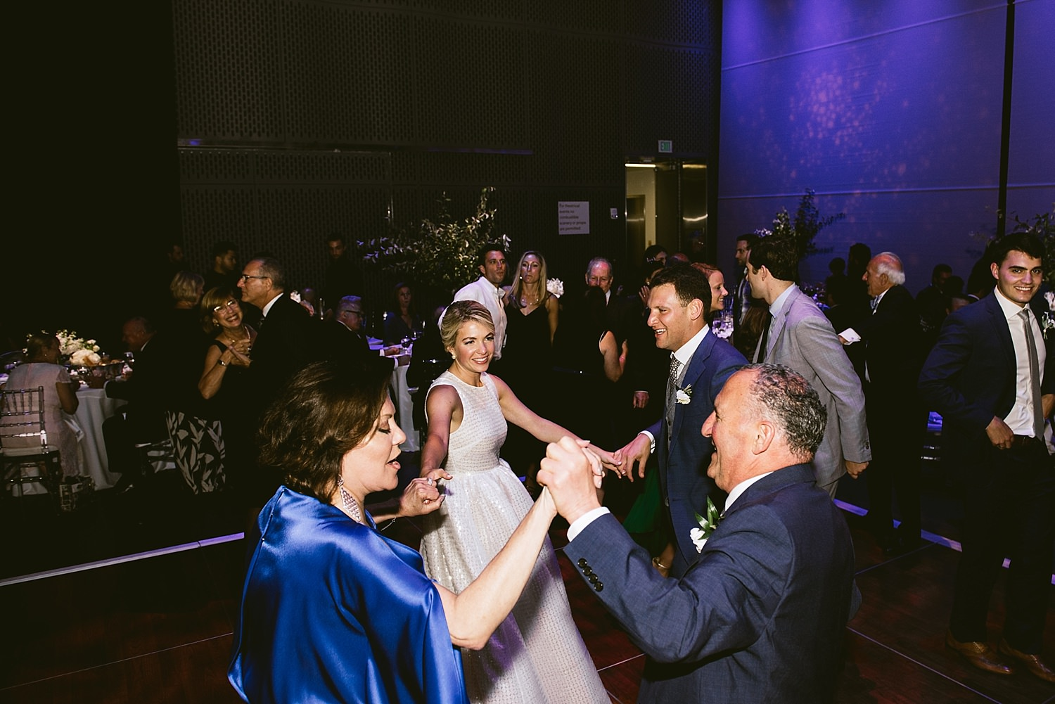 dancing with family at wedding