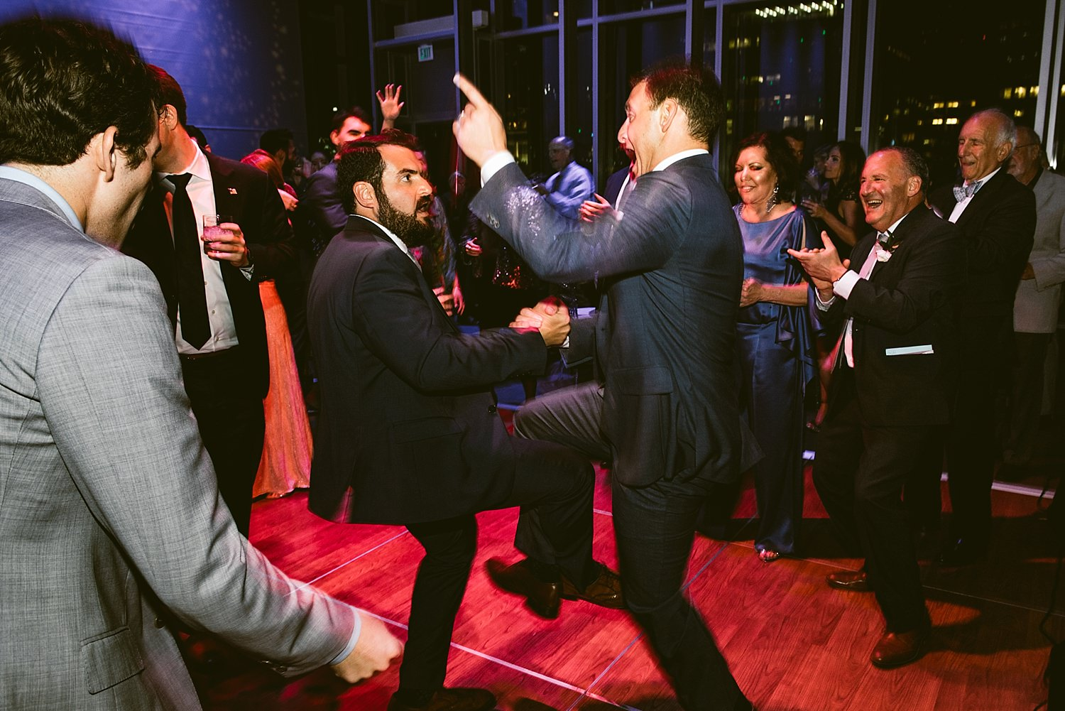 groom dancing with brother