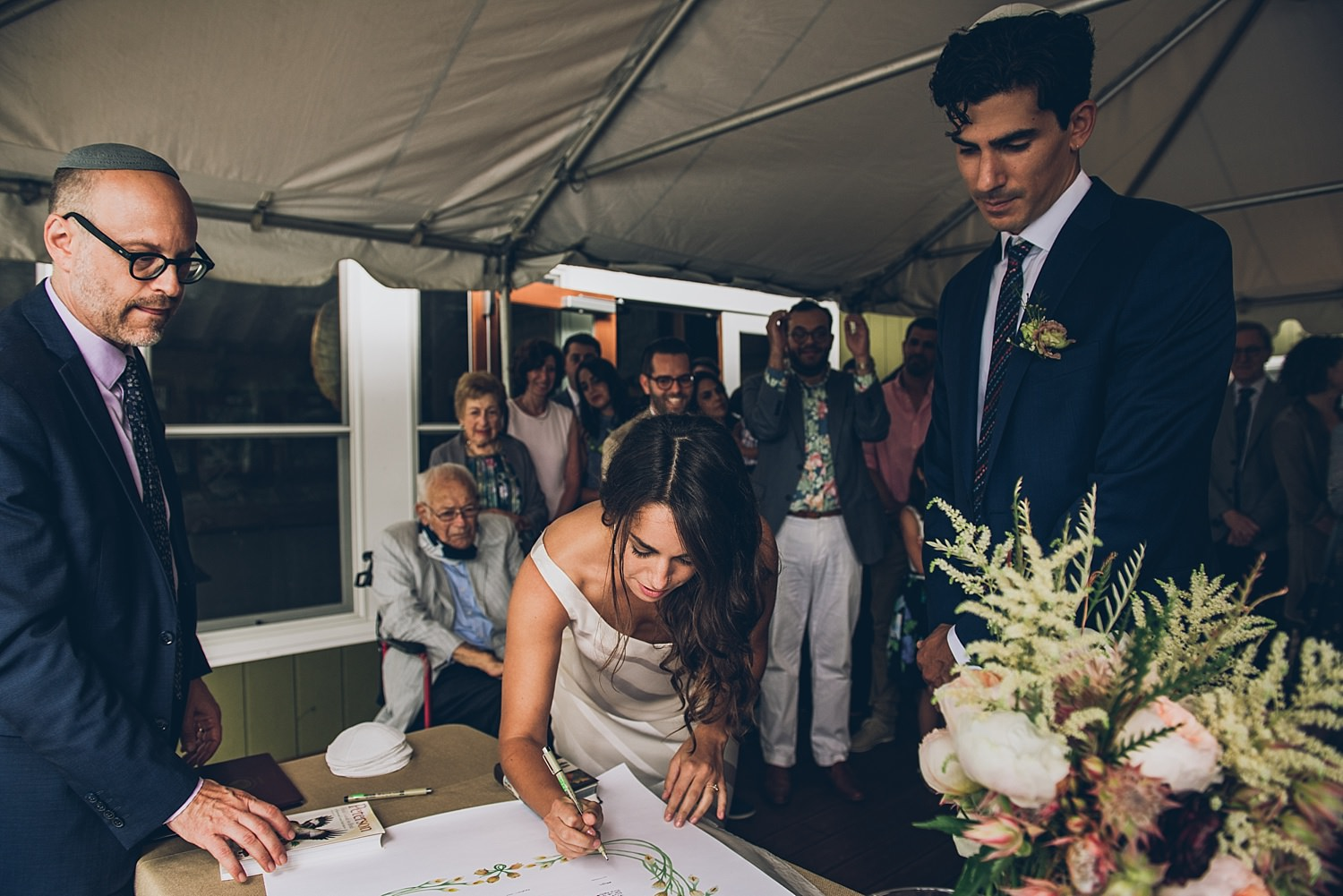 Bride signing the Ketubah