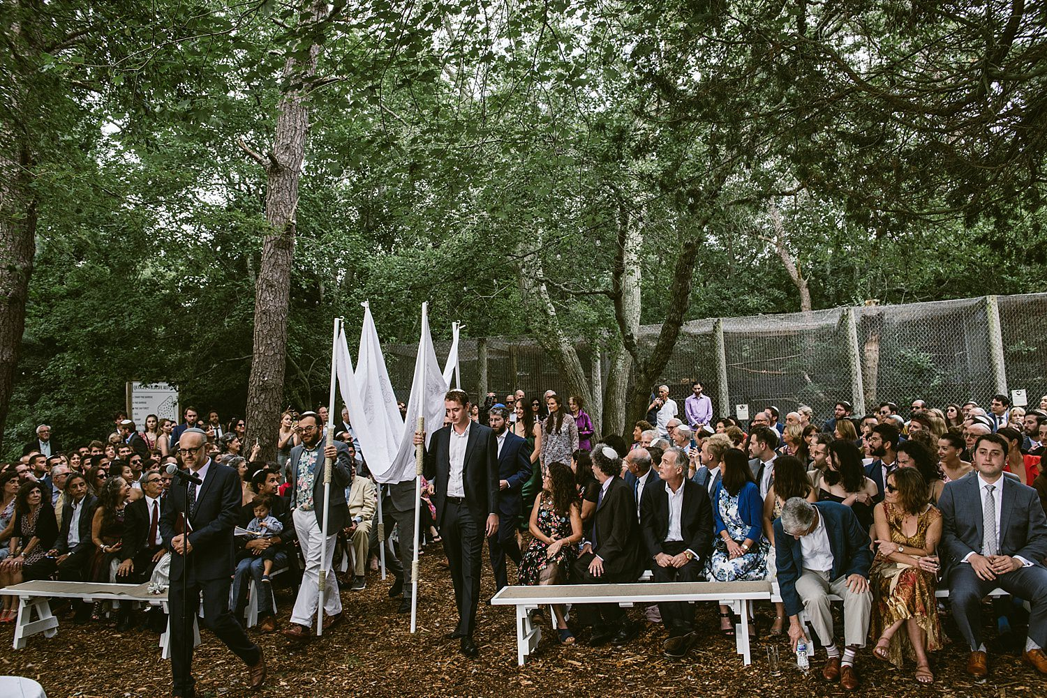 Groomsmen walking in the chuppah