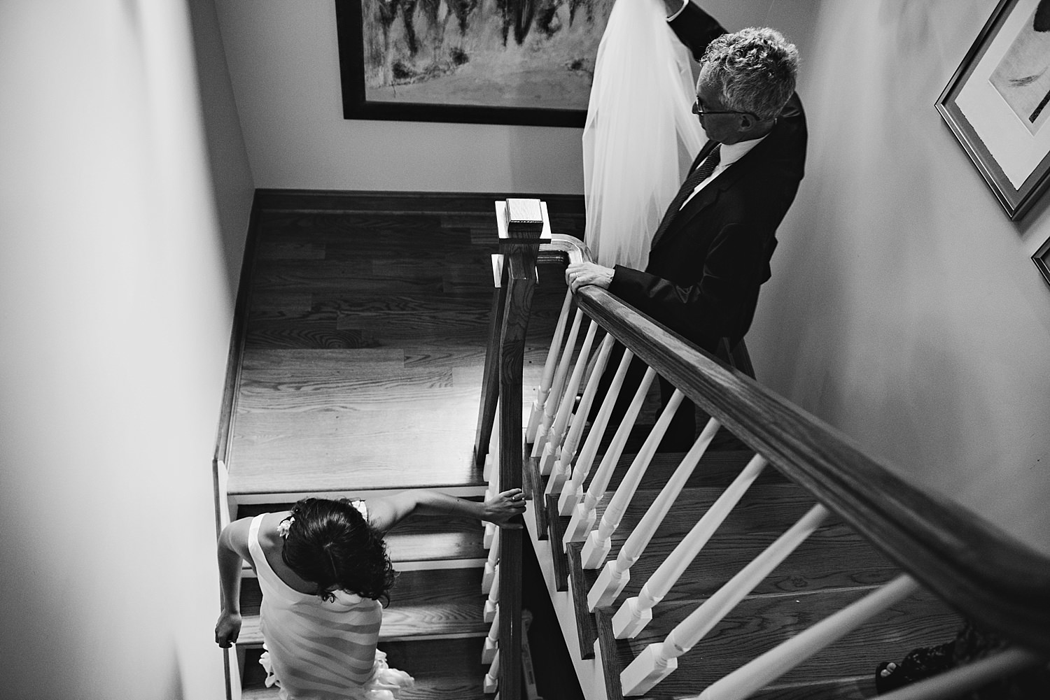 Bride and father walking down the stairs