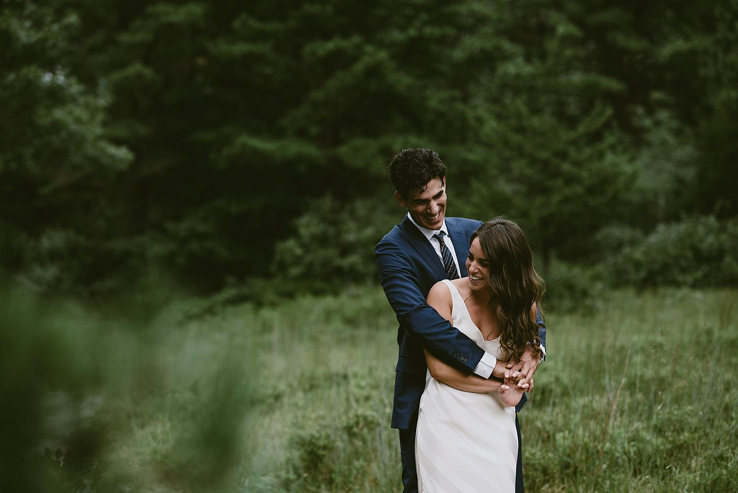 Groom embracing bride