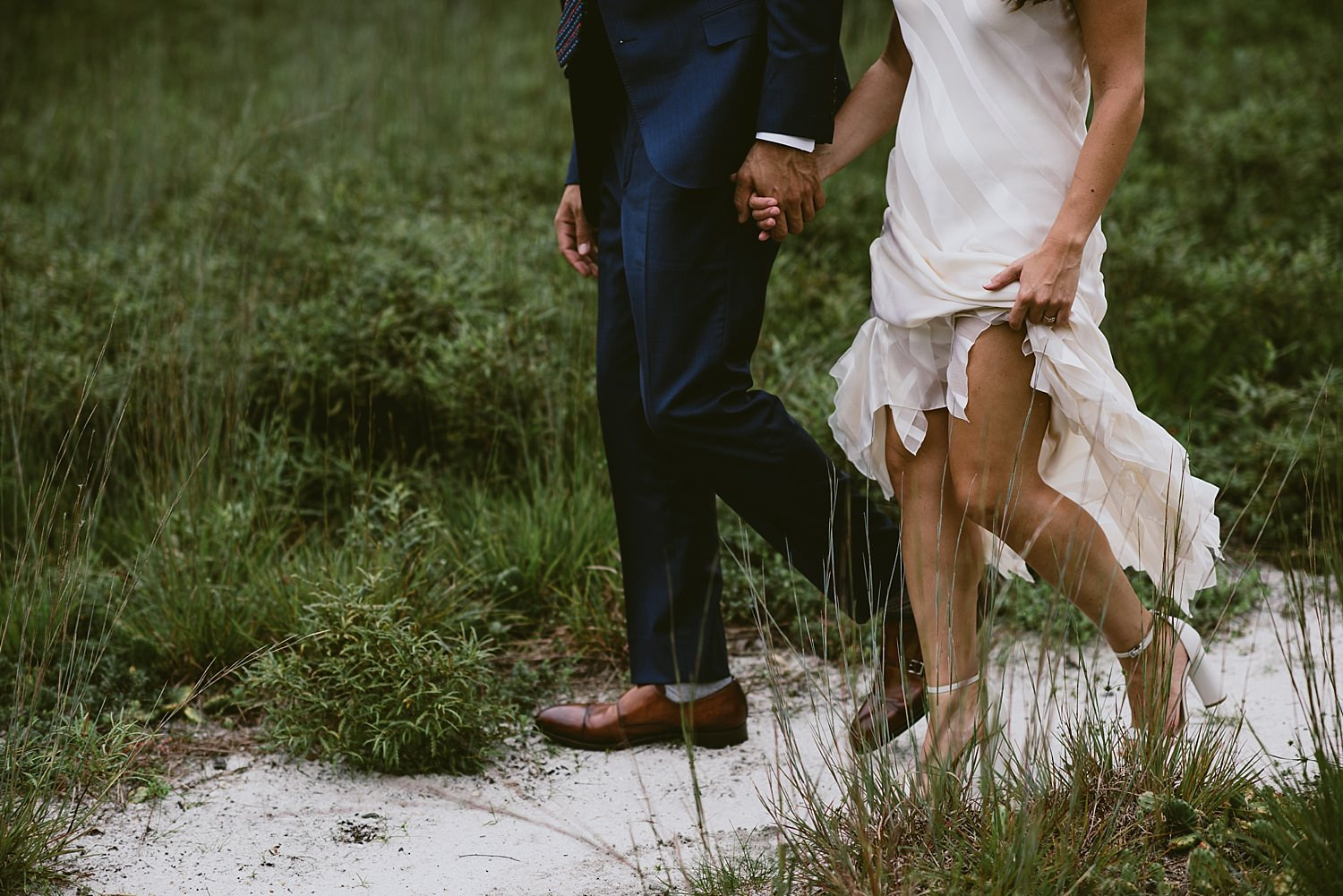 bride and grooms legs walking