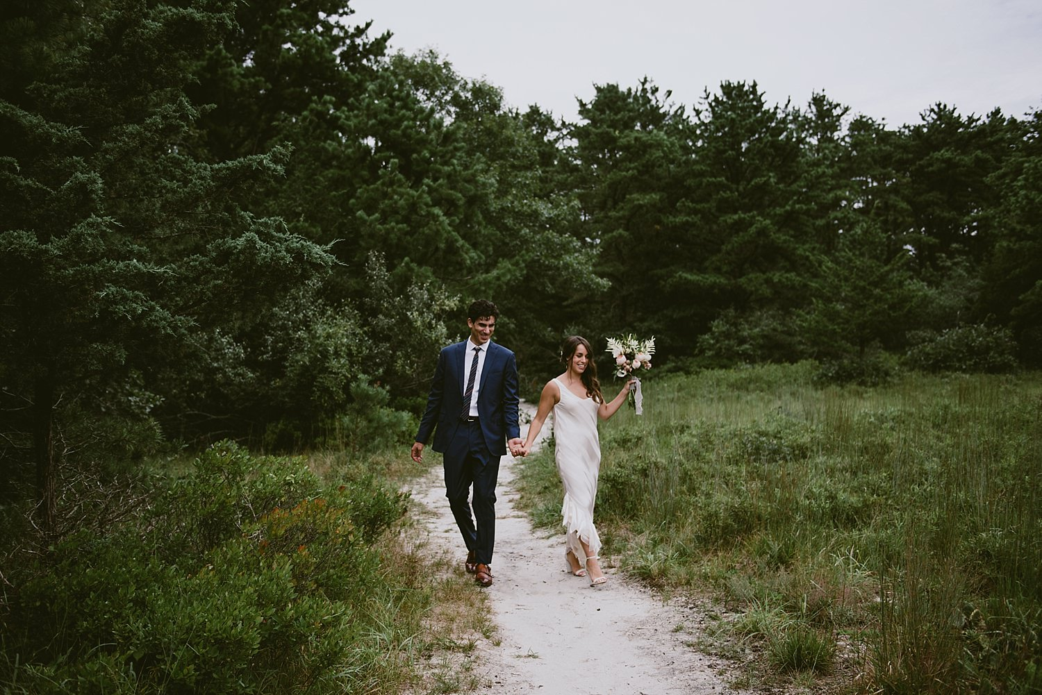 Groom and Bride walking through nature