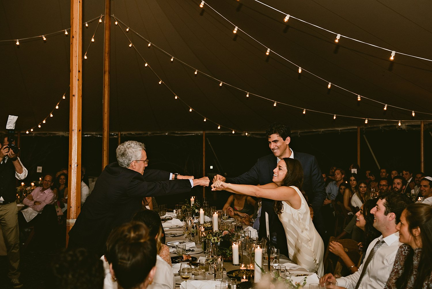 father of the bride giving bride a fist bump