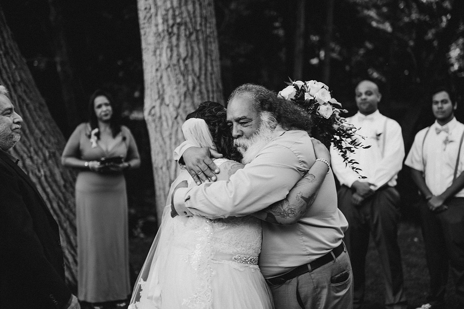 Father of the bride hugging her