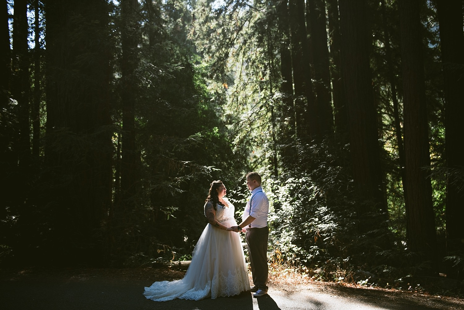 bride and groom in the trees at big sur