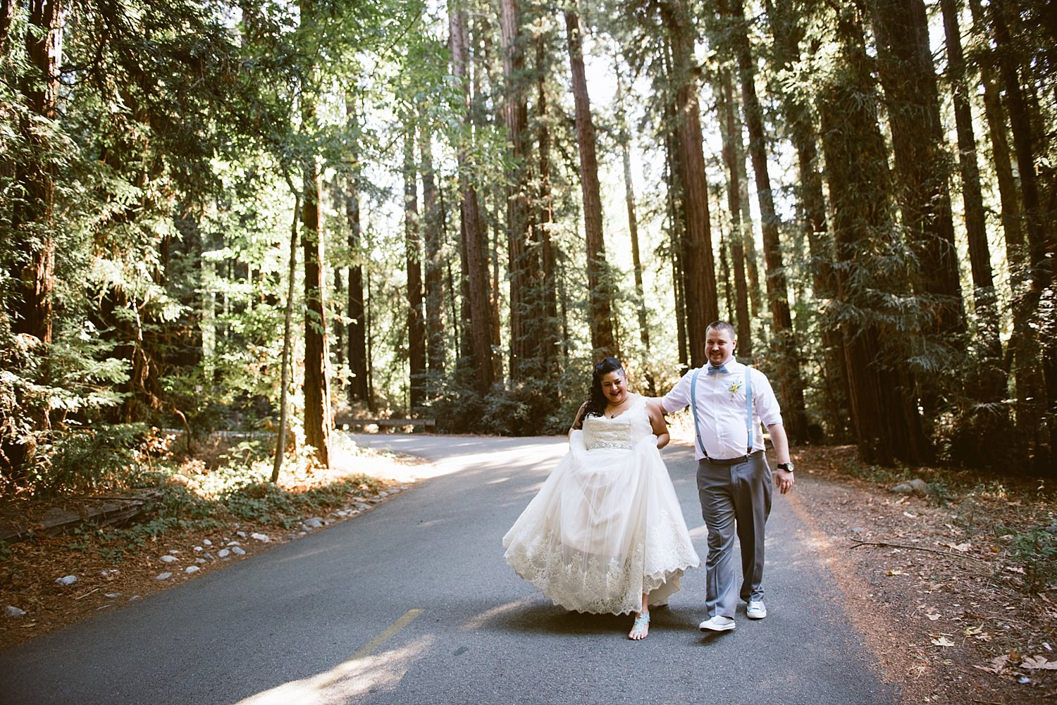 bride and groom walking down the road at big sur