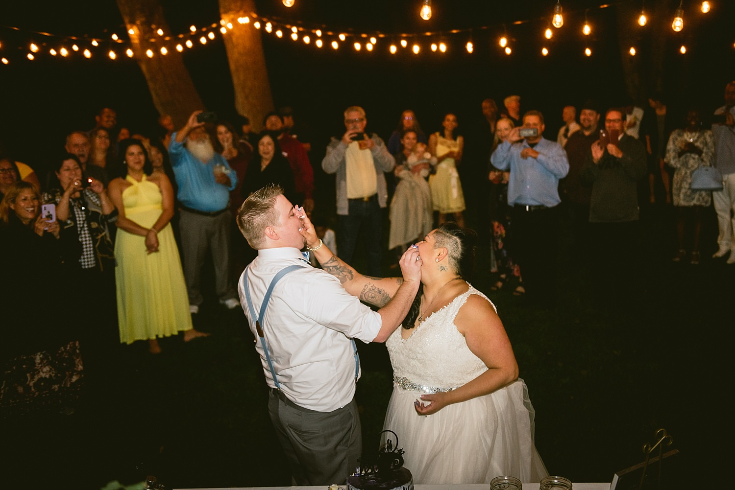 Bride and groom smash cake into faces