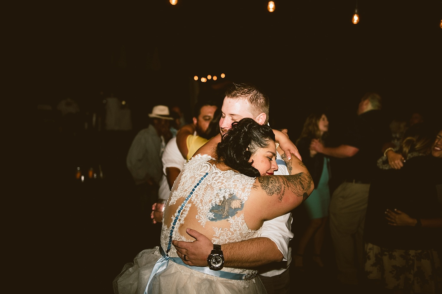 bride and groom hugging at the end of the night