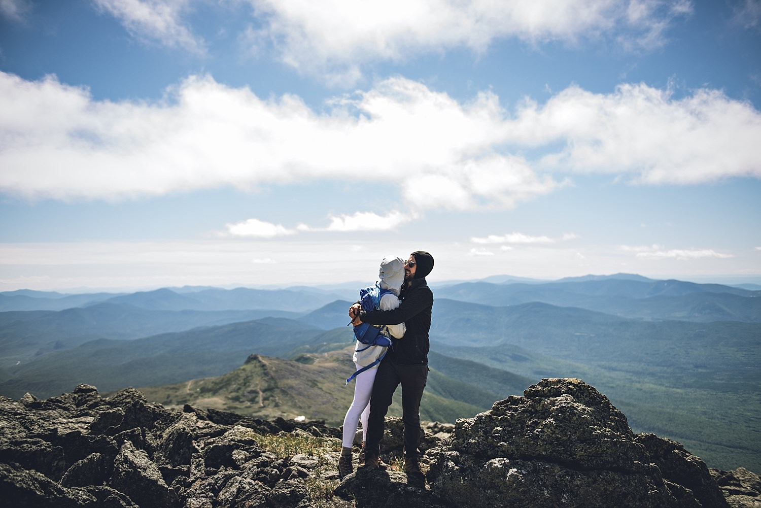 bride and groom portrait on top of the mountain