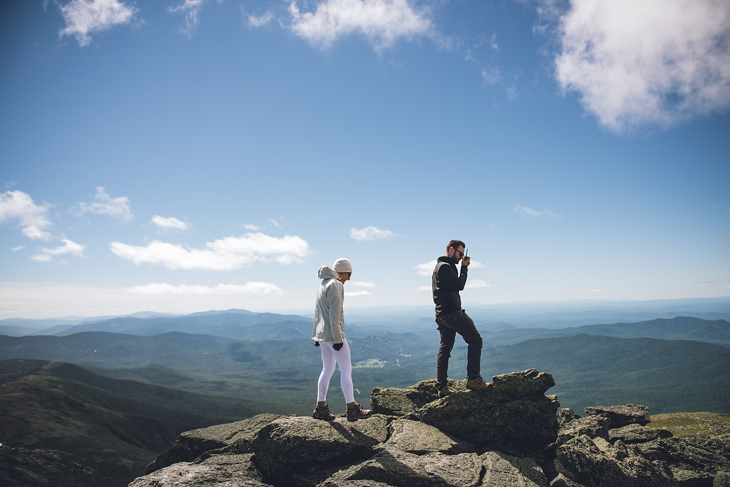 bride and groom walking on the summit