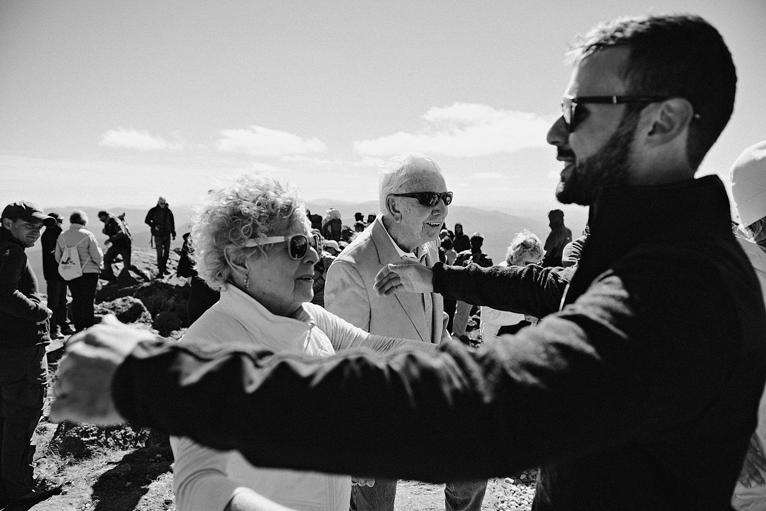 groom hugging grandparents