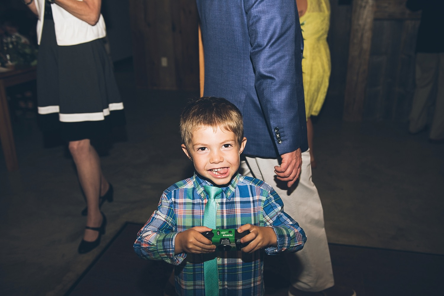 little kid at wedding using a camera