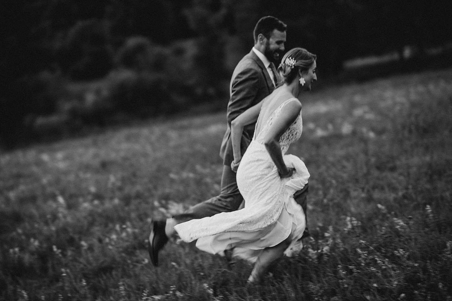 bride and groom portrait, running through a field