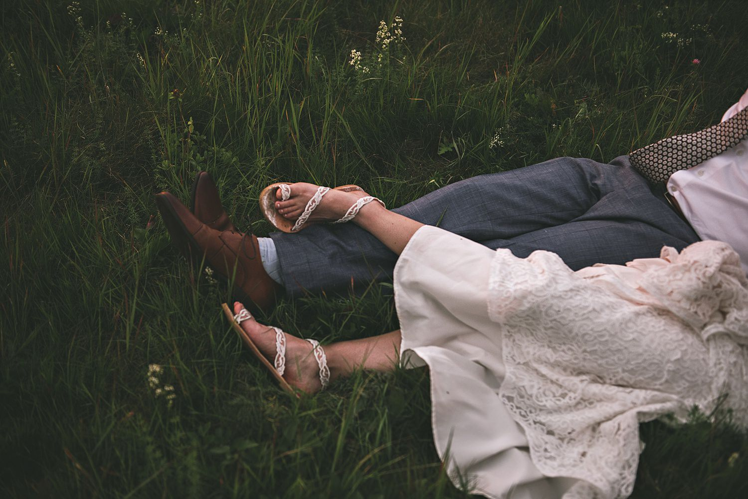 bride and grooms feet in the grass