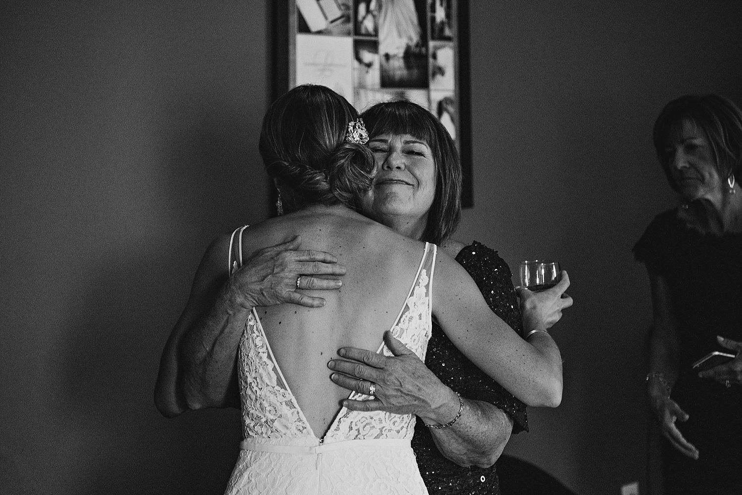 mother of the groom hugging the bride