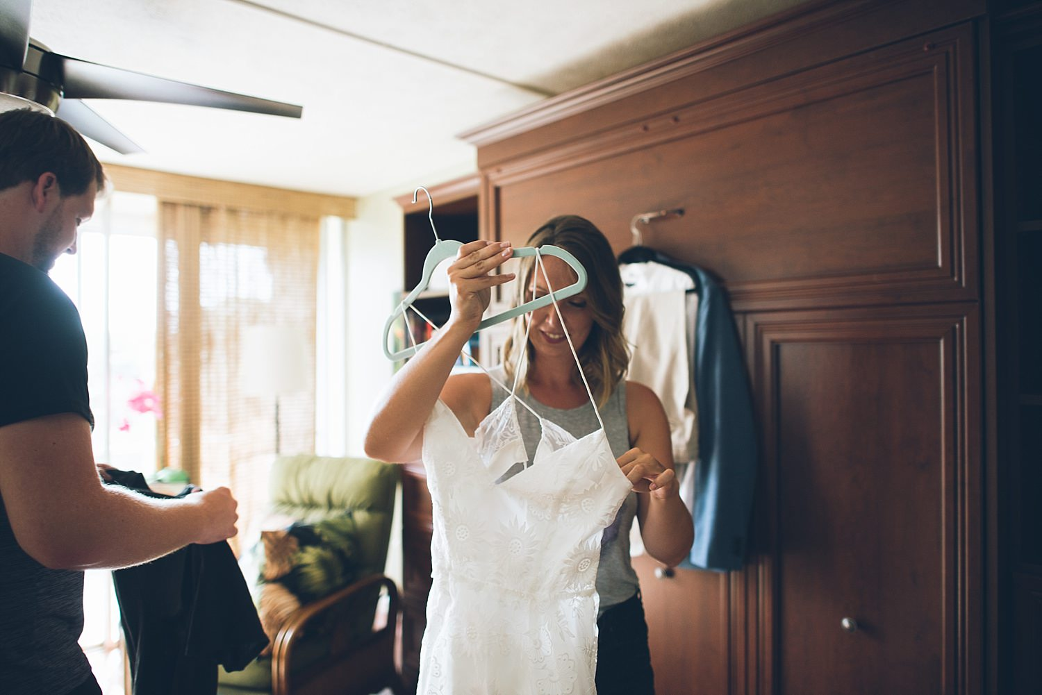bride getting her wedding dress ready