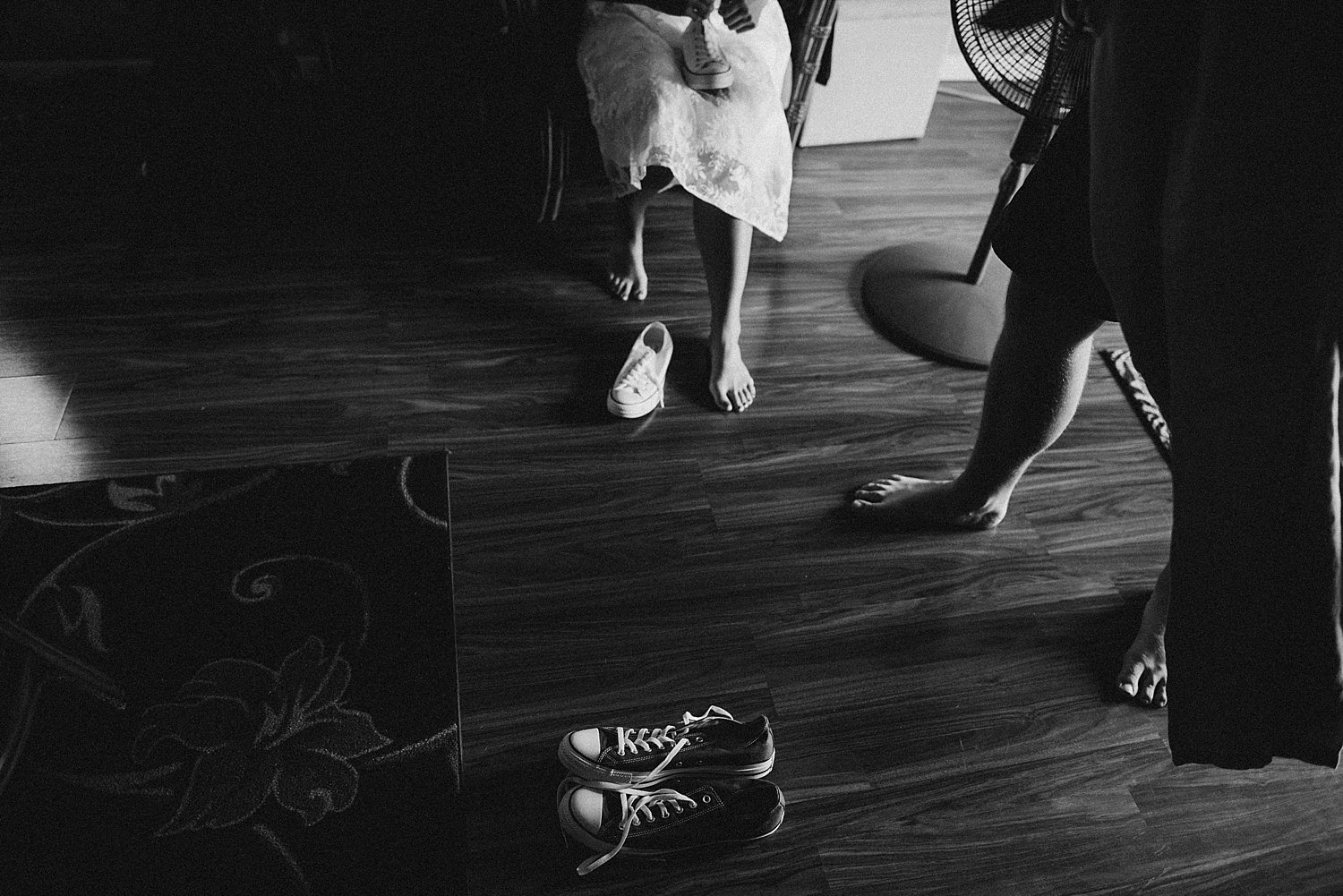 bride and groom getting shoes on