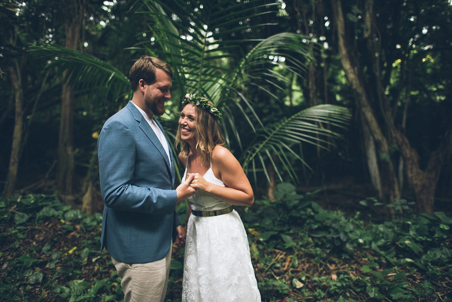 bride and groom laughing in the jungle