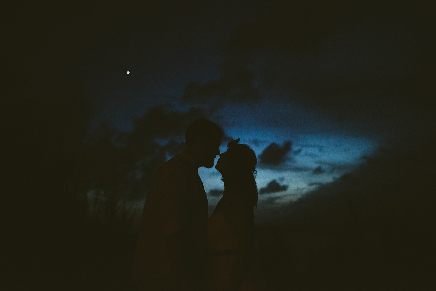 bride and grooms silhouette at sunset