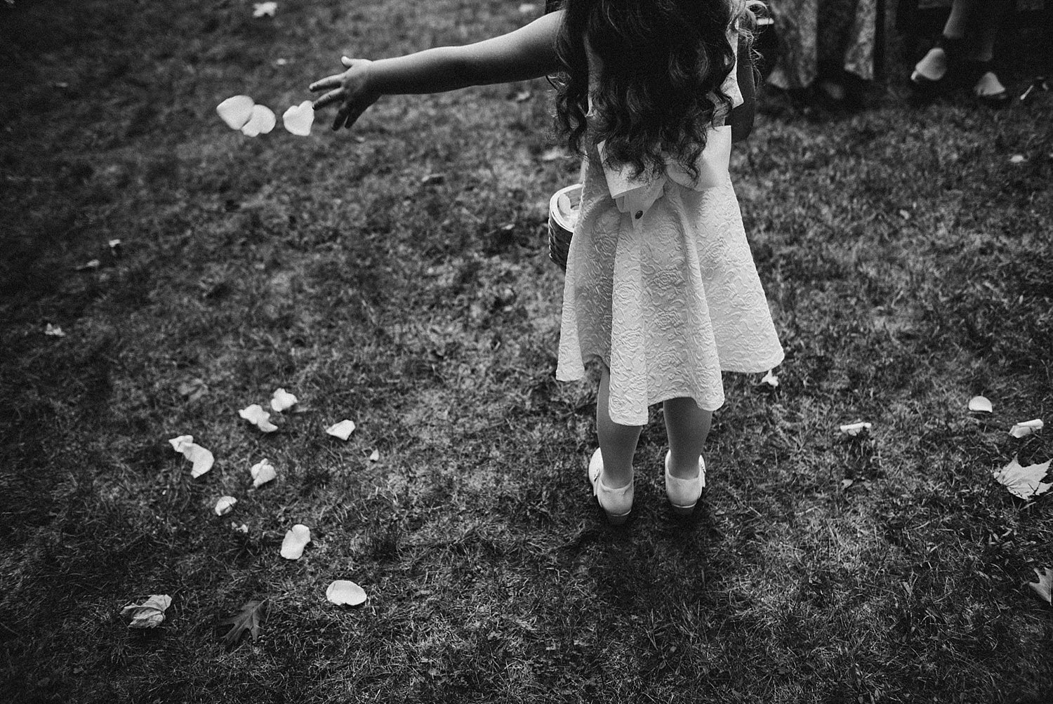 flower girl throwing petals