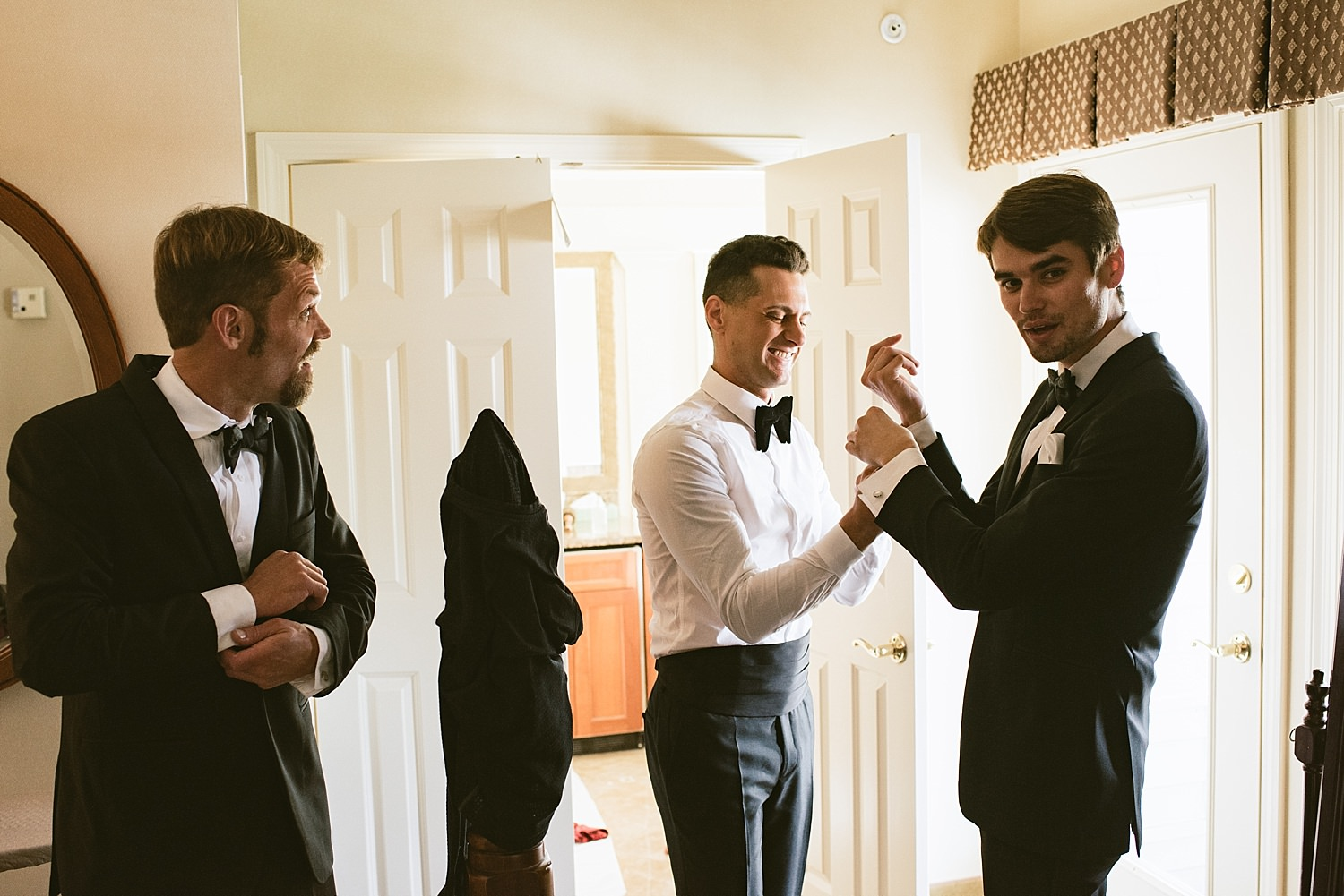 groom helping brother in Law getting ready