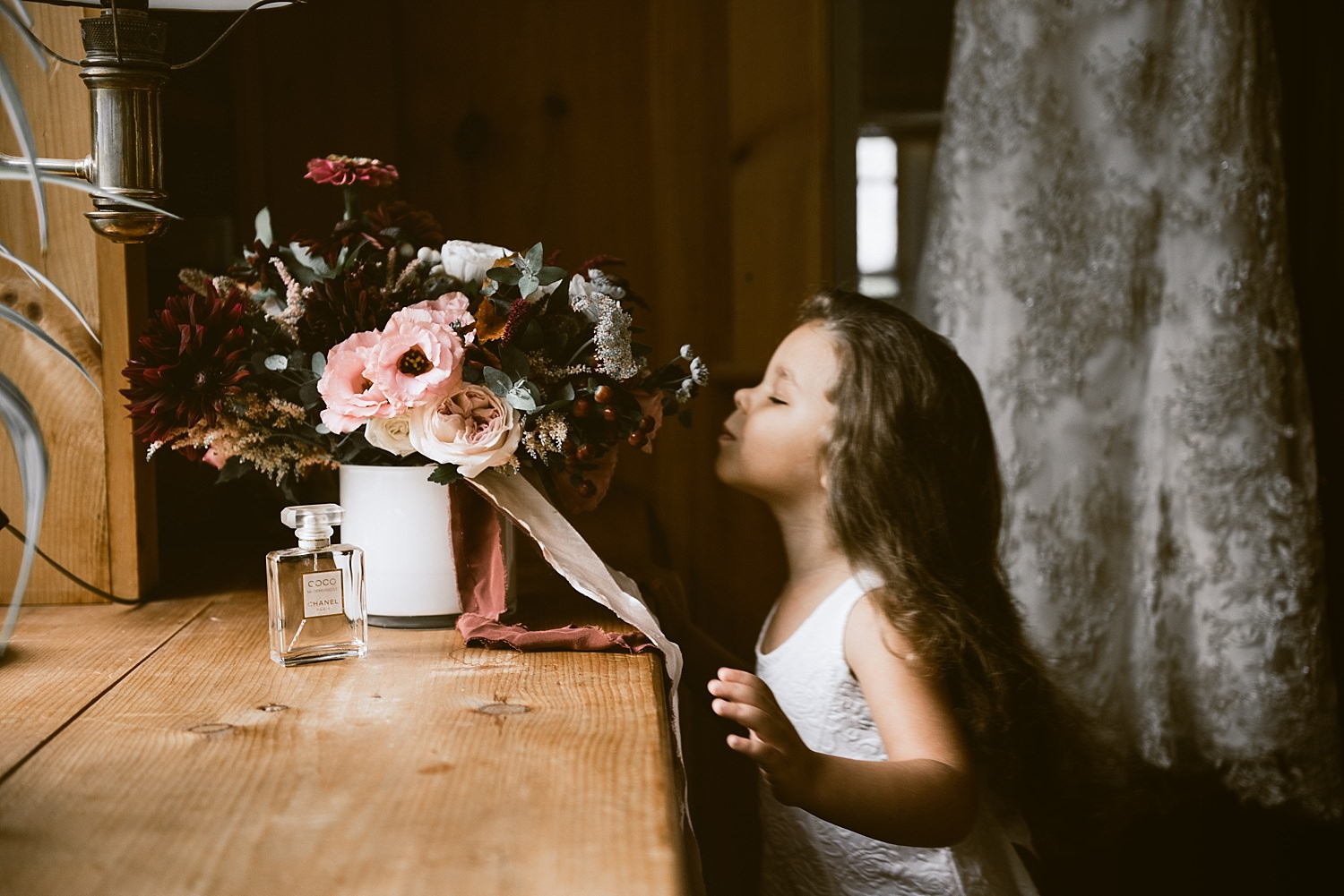 flower girl smelling boquet