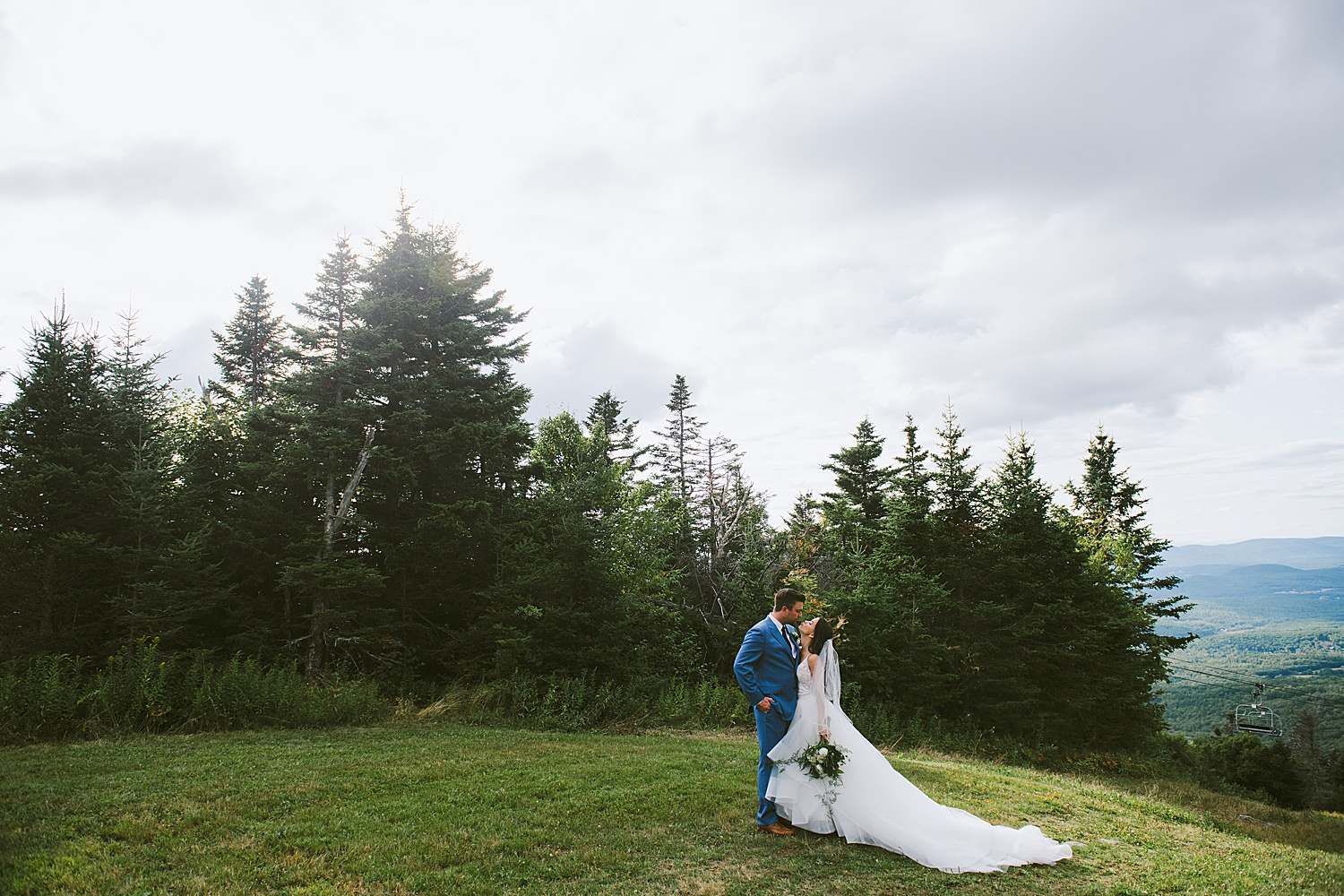 Bride and groom embracing on the mountain