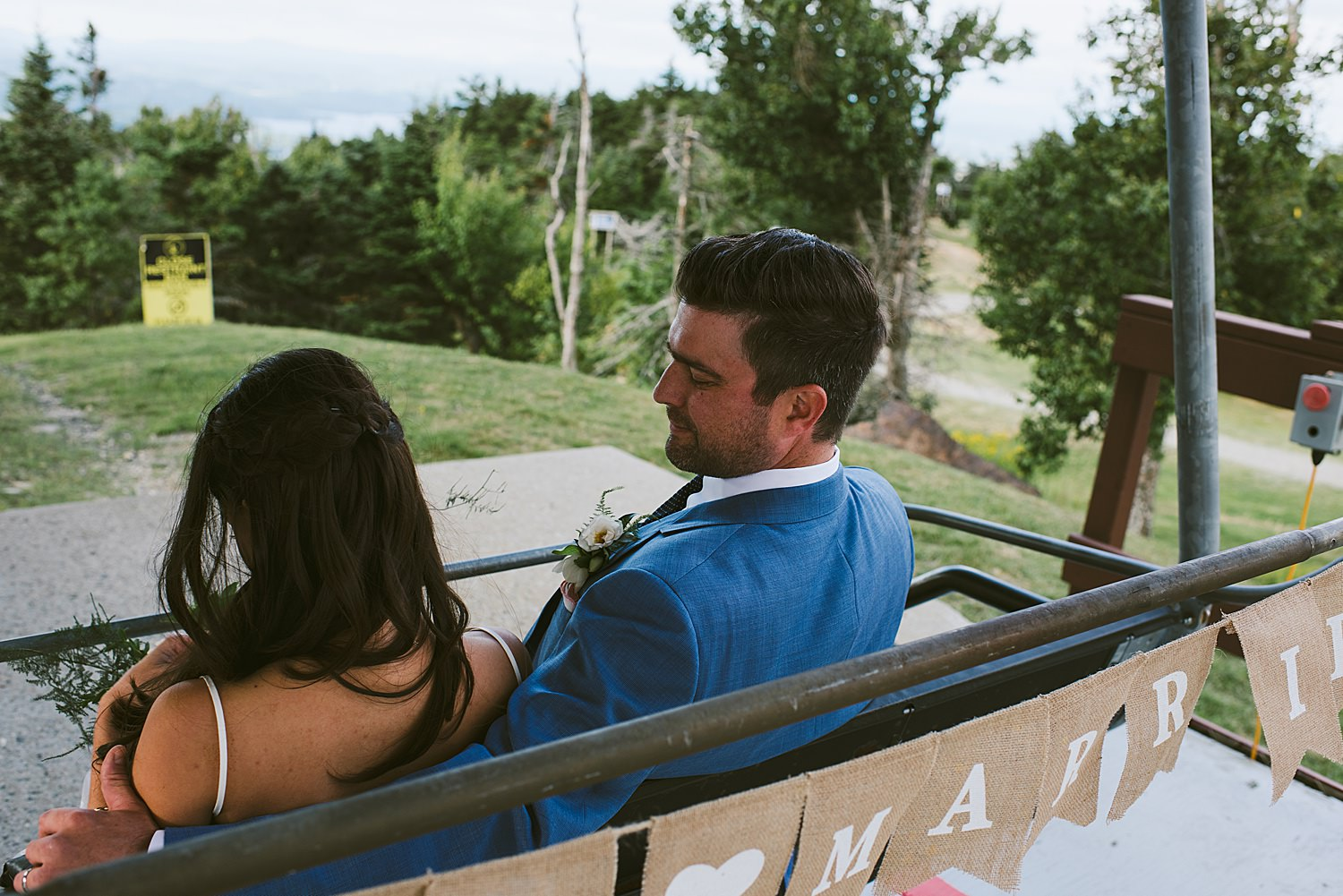 Bride and Groom getting on the chair lift
