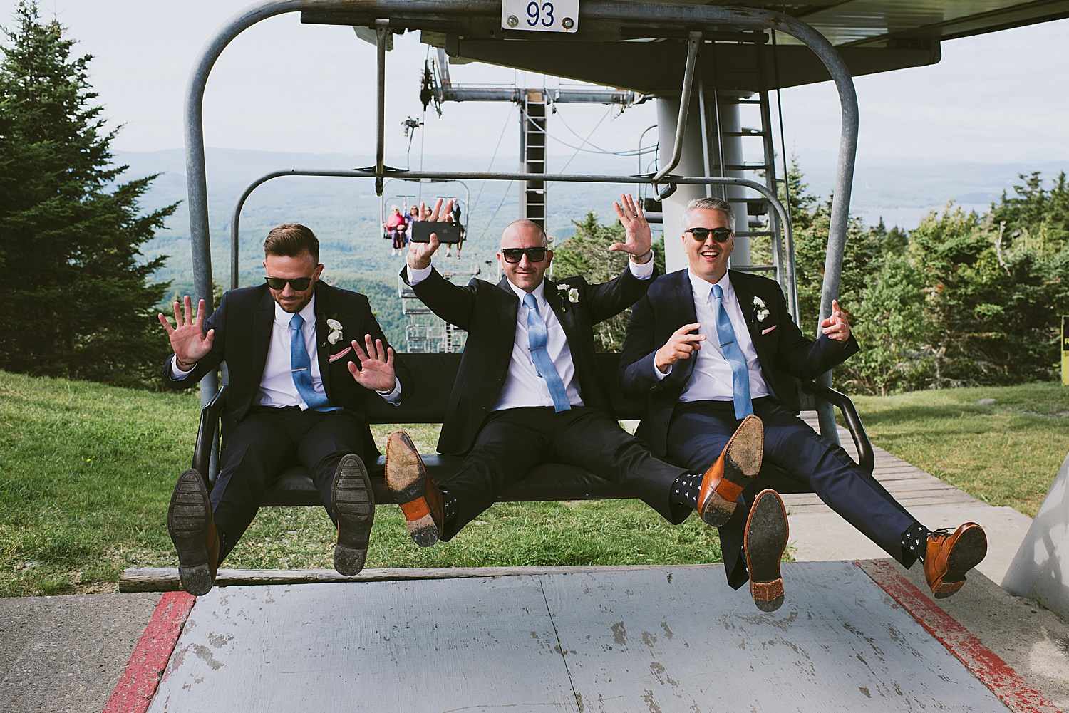 groomsmen riding up on the chair lift