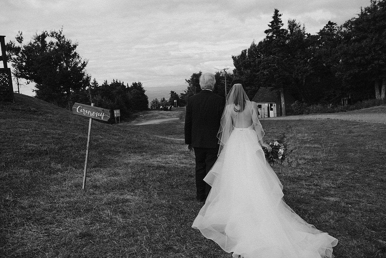 Bride and father walking towards the ceremony
