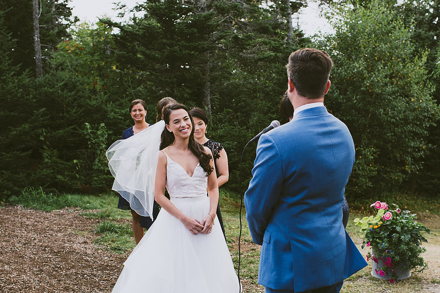 Bride laughing at groom during ceremony