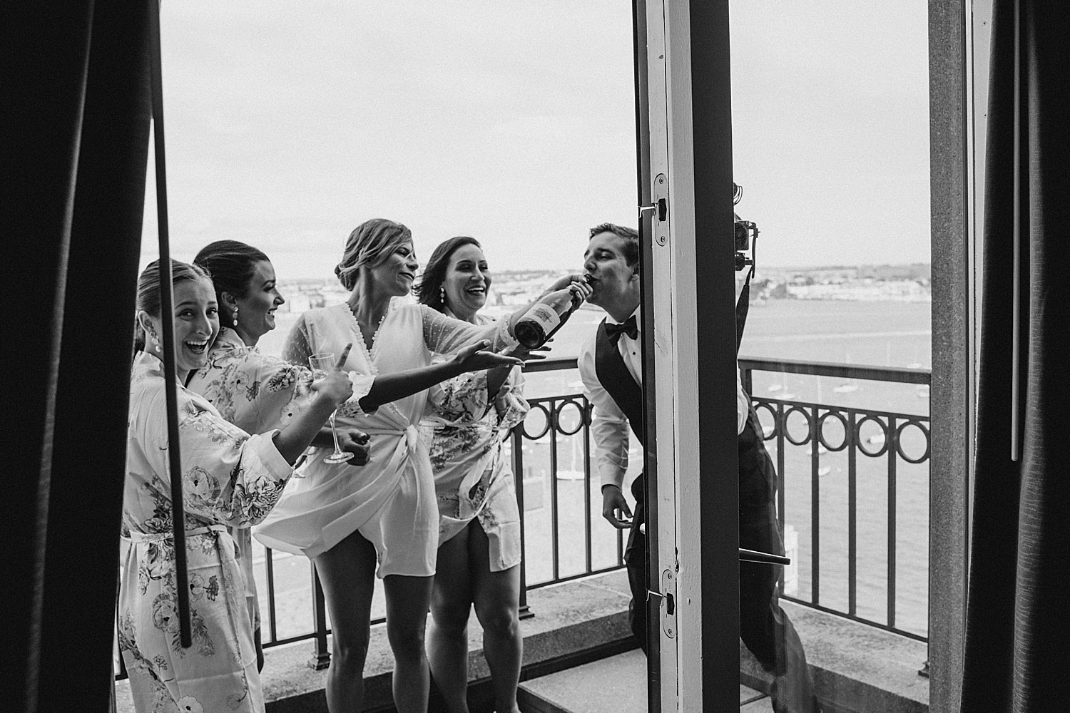 Bride and bridesmaids drinking champagne