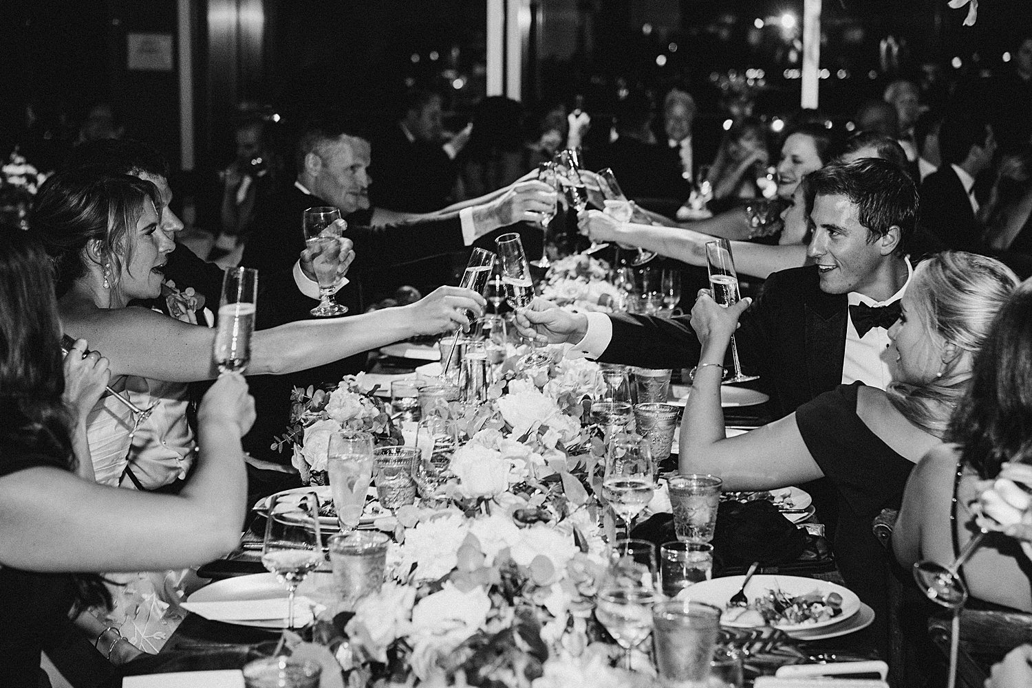 guests toasting at wedding dinner
