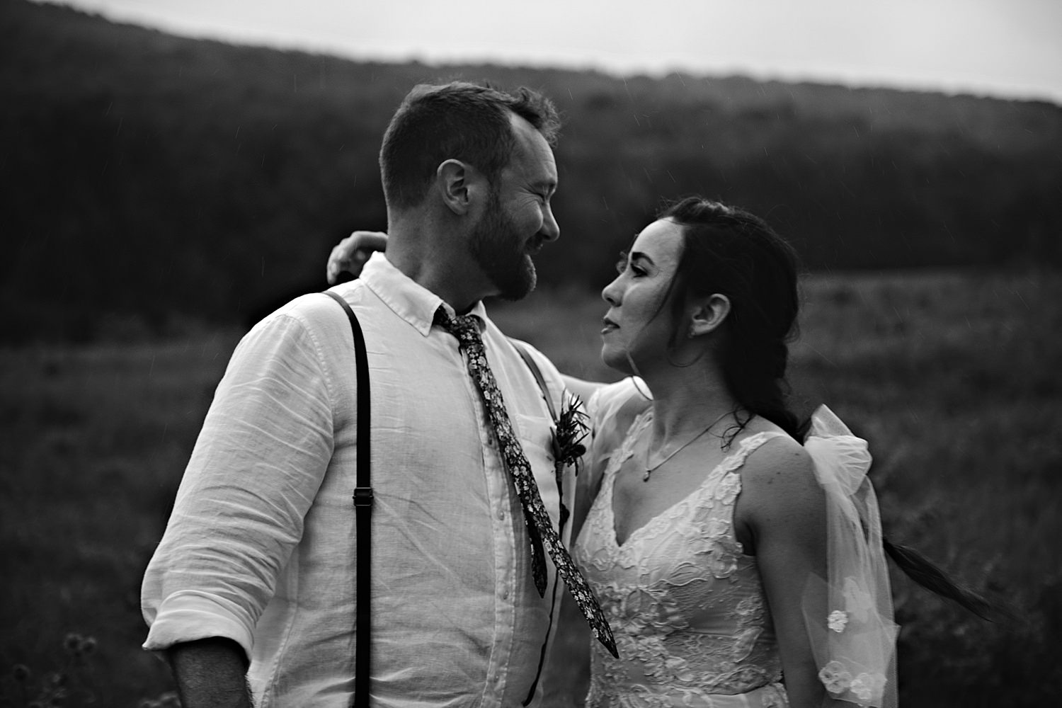moody bride and groom portrait in the rain
